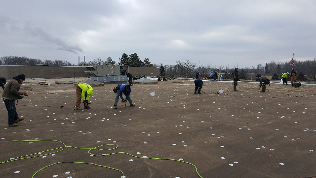 Tri-Star Roofing Team Installing the new insulation.