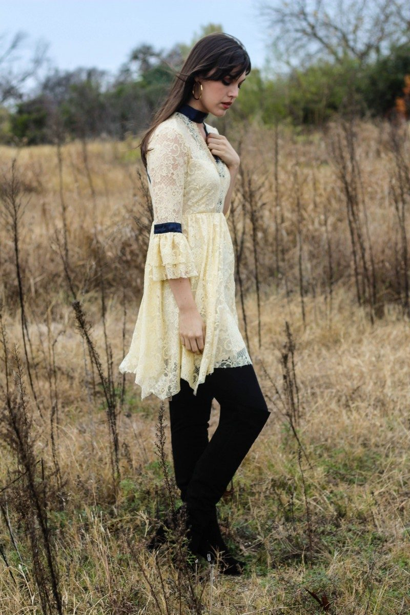 Style blogger Ashley Deatherage of Never Without Lipstick wears a lace dress and over the knee boots for a boho New Year's Eve outfit idea | new year's eve dress, new years eve outfit, new years eve dress boho, lace dress, boho dress outfit, over the knee boots outfit | Boho New Years outfit featured by top US fashion blog, Never Without Lipstick: image of a woman wearing a Free People lace dress and Steve Madden OTK boots.