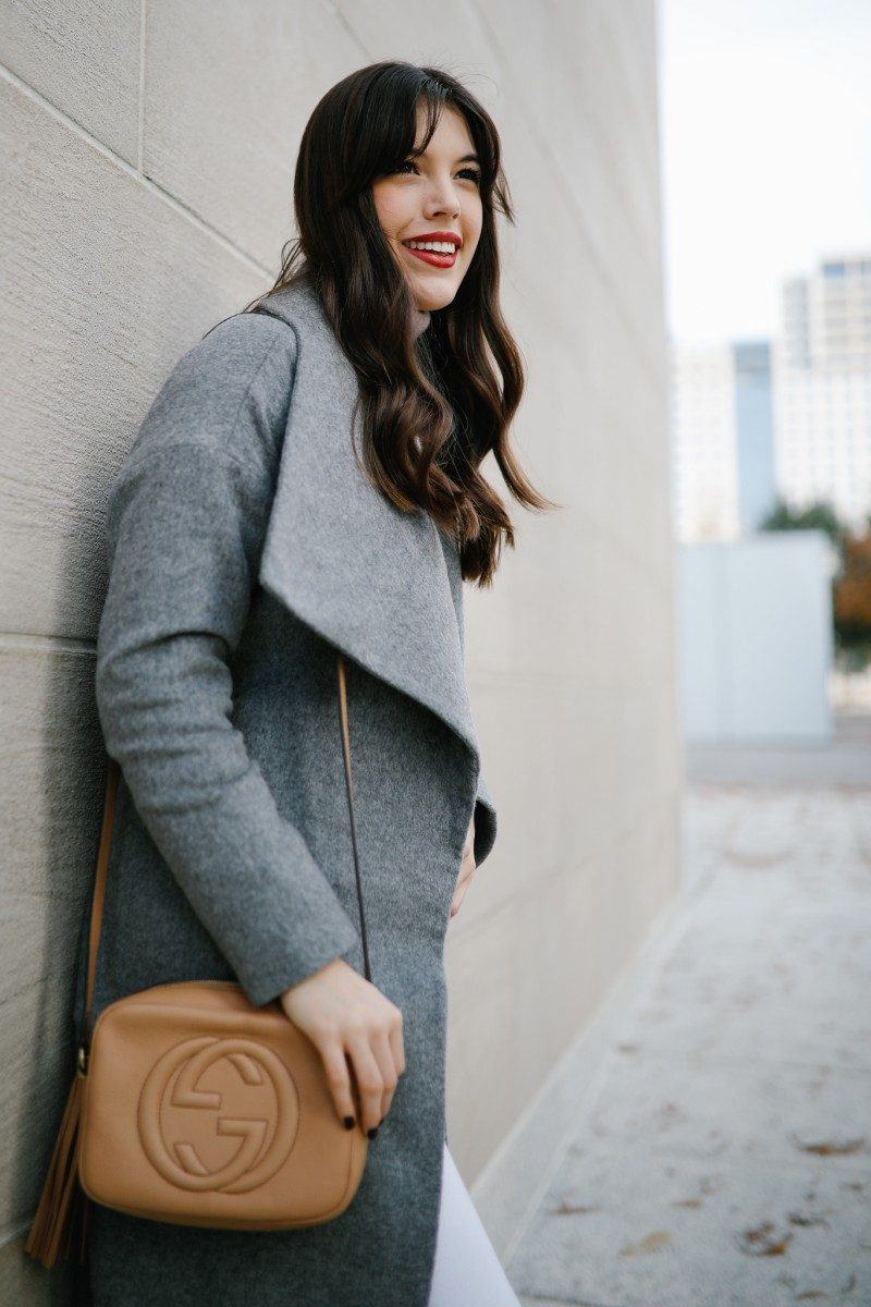 Style blogger Ashley Deatherage of Never Without Lipstick wears a wool wrap coat, white jeans, and booties | winter wardrobe essentials, winter outfit, winter outfit going out, winter style, winter outfit idea, gucci soho disco, valentino rockstud, turtleneck outfit, wrap coat