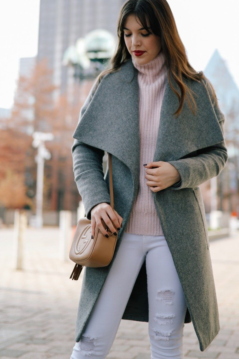 Style blogger Ashley Deatherage of Never Without Lipstick wears a wool wrap coat, white jeans, and booties | winter wardrobe essentials, winter outfit, winter outfit going out, winter style, winter outfit idea, gucci soho disco, valentino rockstud, turtleneck outfit