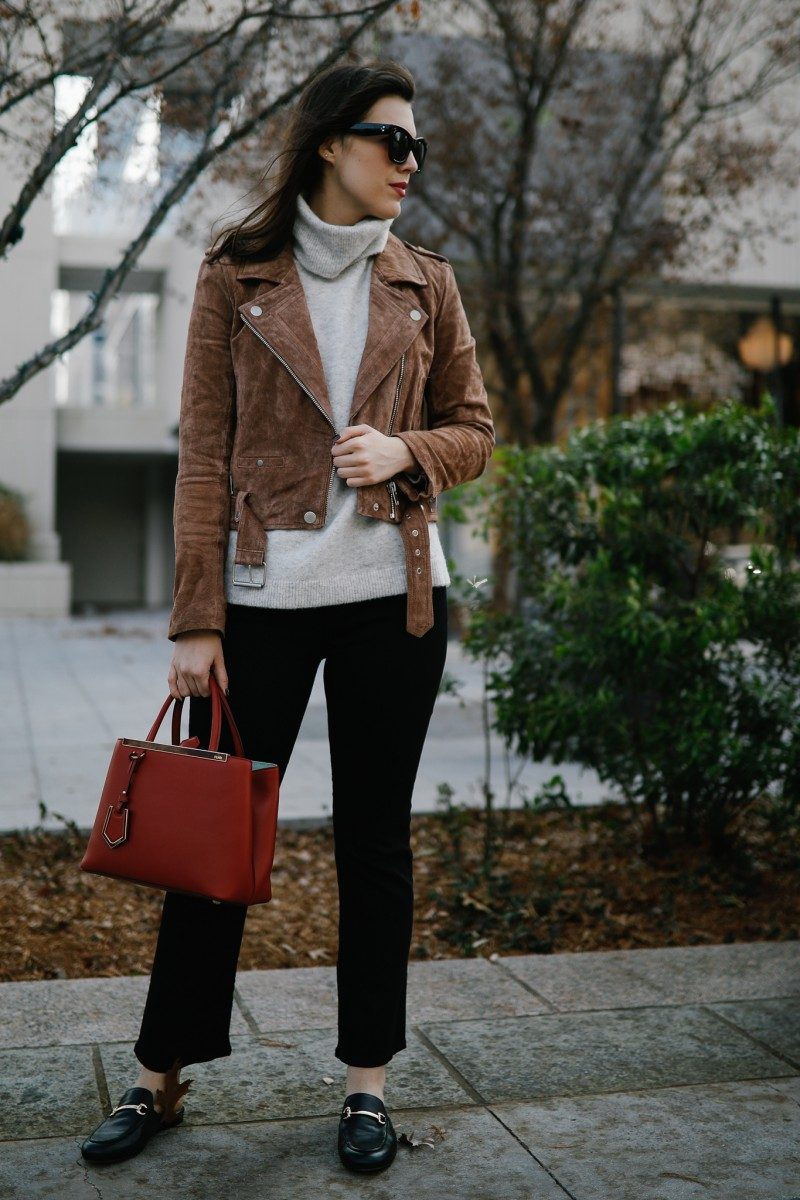 Style blogger Ashley of Never Without Lipstick wears black crop flare jeans with a turtleneck and suede moto jacket | winter outfit, crop flare jeans outfit, turtleneck outfit, suede moto jacket, fendi petit 2jours