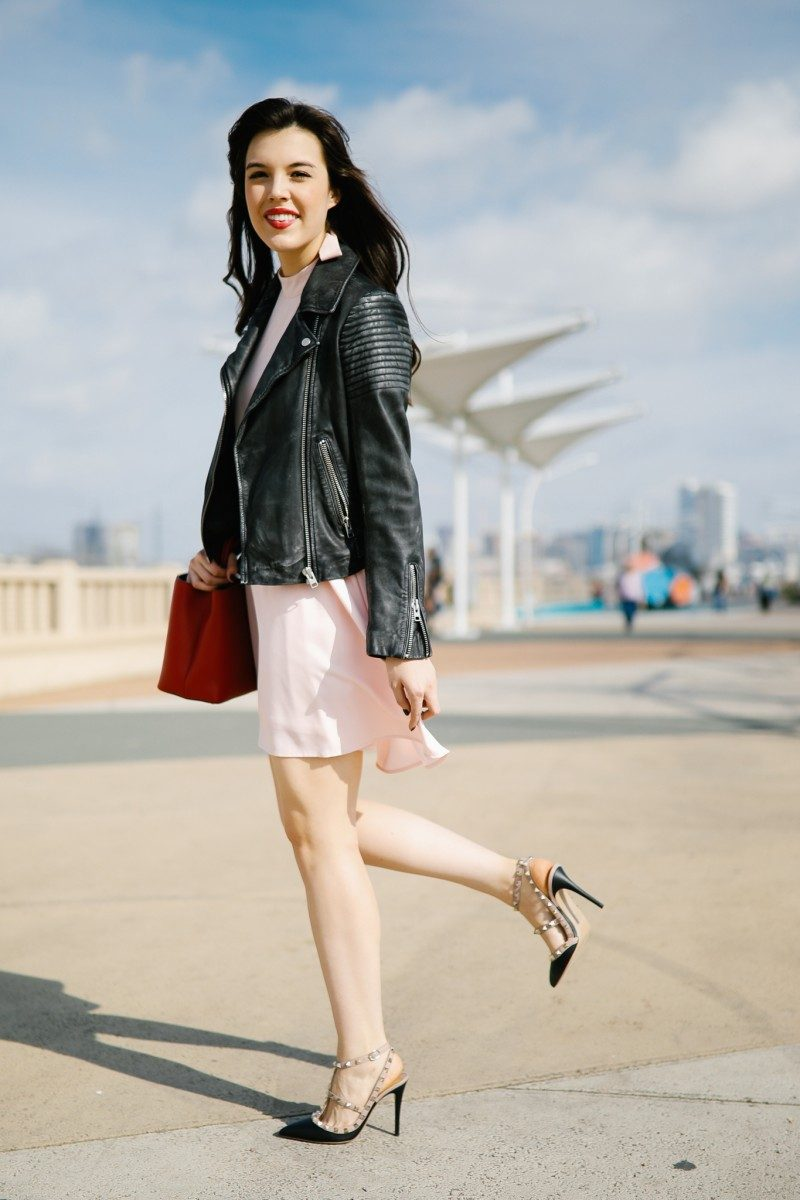 Valentine's Day Date Night Look featured by top US fashion blog, Never Without Lipstick: image of a woman wearing a Lulus blush dress and a TOPSHOP leather biker jacket