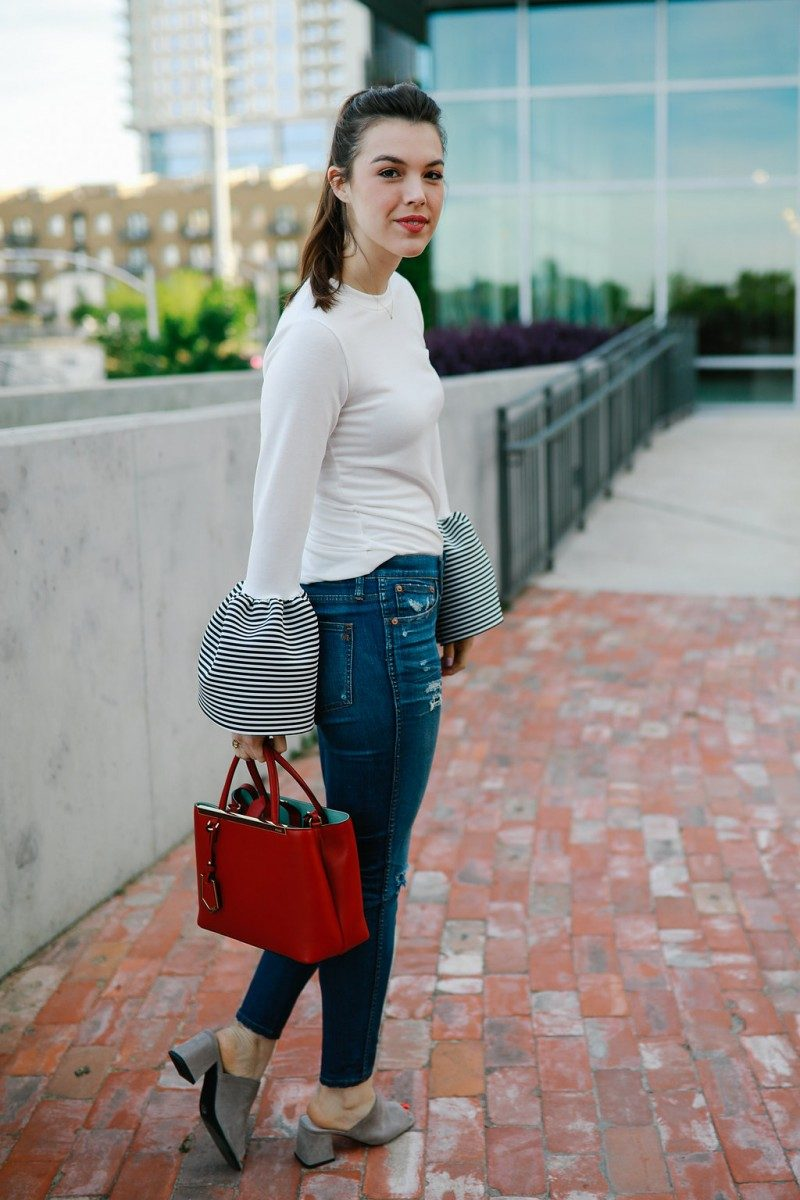 Style blogger Ashley of Never Without Lipstick wears statement sleeve blouse with distressed jeans   statement sleeves, statement sleeves 2017, statement sleeves outfit, statement sleeves classy, trumpet sleeves, trumpet sleeve top, trumpet sleeve top outfit, casual workwear, chic office style, fendi petit 2jours
