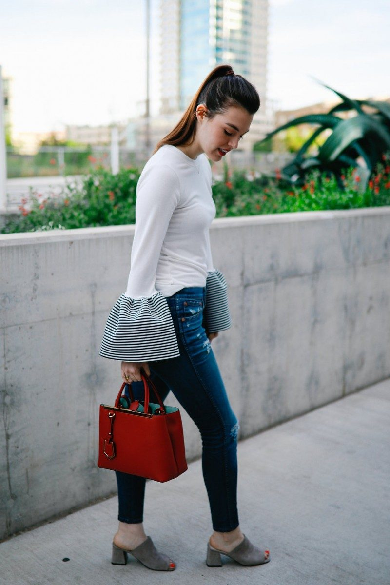 Style blogger Ashley of Never Without Lipstick wears statement sleeve blouse with distressed jeans   statement sleeves, statement sleeves 2017, statement sleeves outfit, statement sleeves classy, trumpet sleeves, trumpet sleeve top, trumpet sleeve top outfit, casual workwear, chic office style
