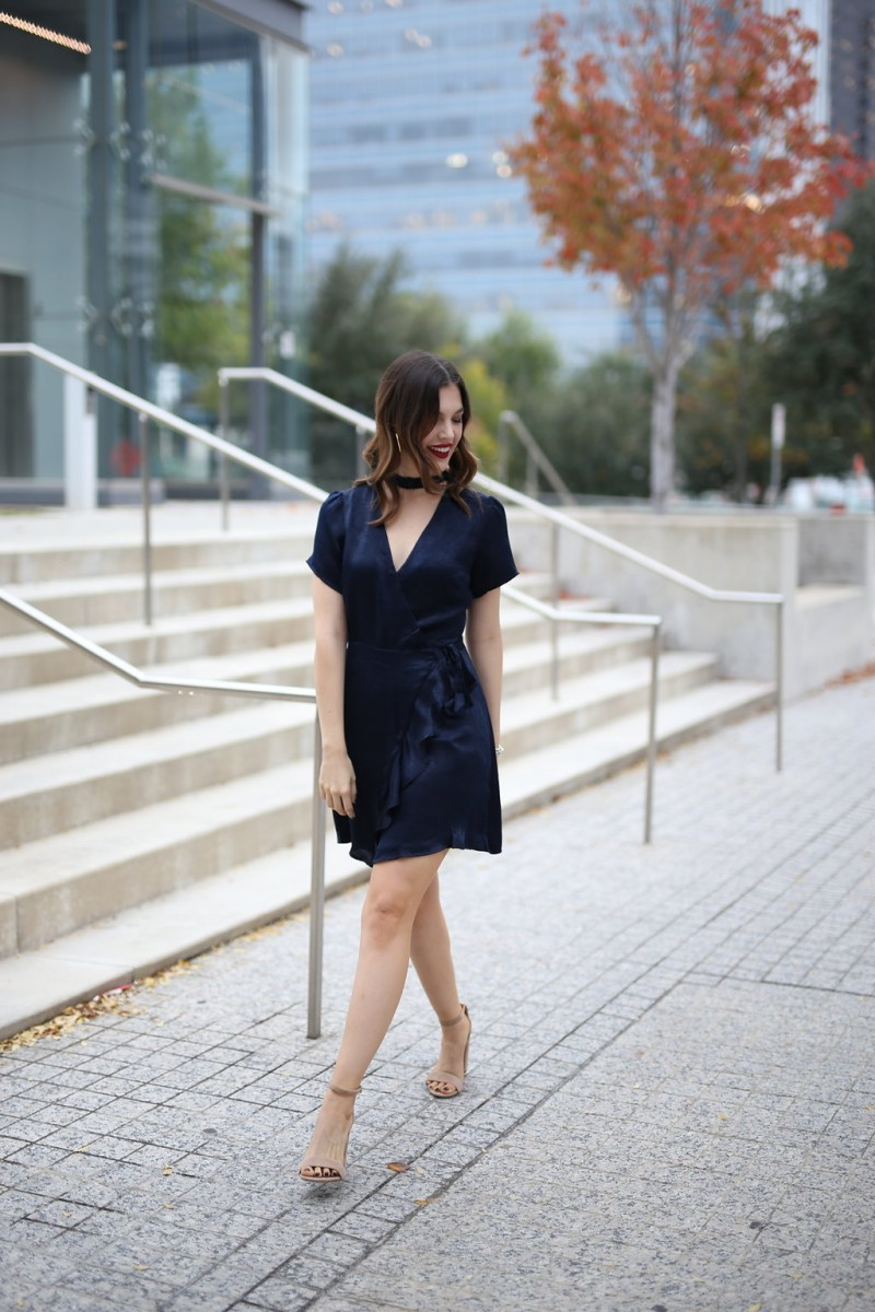 Style blogger Ashley Lane of Never Without Lipstick wears a navy wrap dress with block heels   holiday party dresses, affordable holiday party dresses, holiday party dresses under 50, holiday party outfit, holiday party outfit idea, wrap dress, navy dress, holiday party dress christmas, holiday party dress work