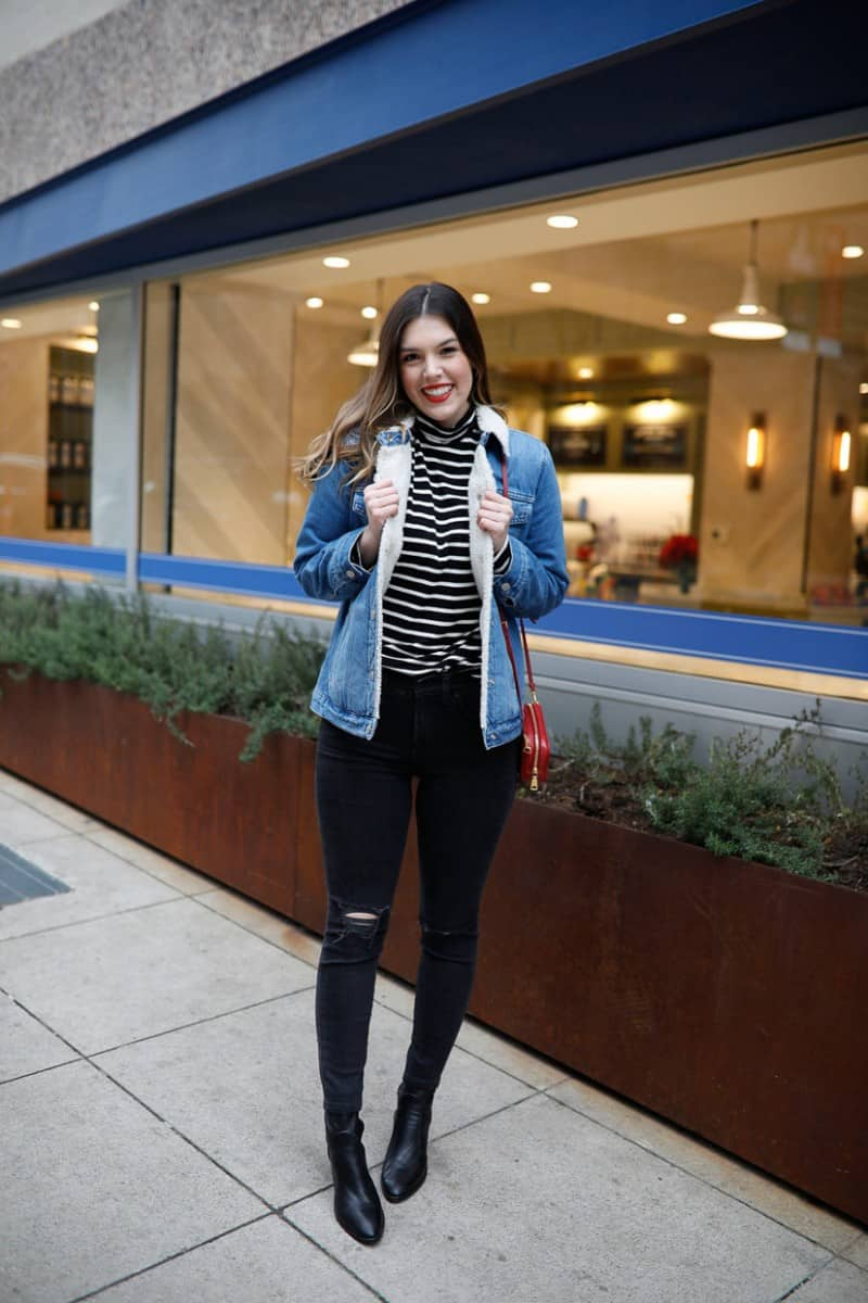 sherpa denim jacket outfit, sherpa denim jacket outfit women, winter sherpa denim jacket outfit, casual sherpa denim jacket outfit, madewell oversized jean jacket, oversized sherpa denim jacket, sock boots, striped turtleneck, madewell ripped skinny jeans, casual style, everyday style, womens outfit inspiration | The Perfect Sherpa Denim Jacket for the Weekend featured by top Dallas fashion blog, Never Without Lipstick: image of a woman wearing a Madewell sherpa denim jacket, H&M striped turtleneck top, Madewell black skinny jeans, Topshop social bootie, Parada camera bag and Madewell hoop earrings
