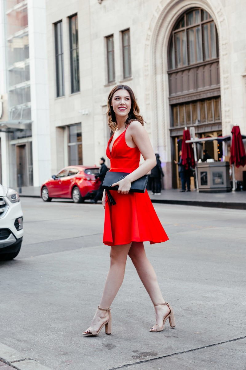 valentines day outfits, valentines looks, red dress outfit, date night outfit, womens style, womens outfit ideas, gucci clutch bag   5 Effortless Valentine's Day Outfits styled by top US fashion blog, Never Without Lipstick: image of a woman wearing a red Mac Duggal dress, Sam Edelman sandals and a Mango coat