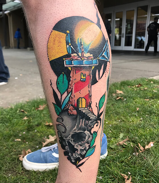 Lighthouse skull and candle tattoo
