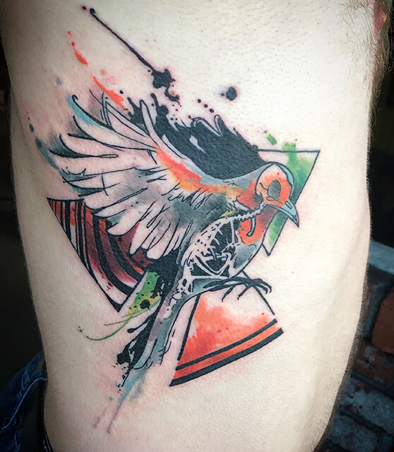 Watercolor bird and skeleton tattoo