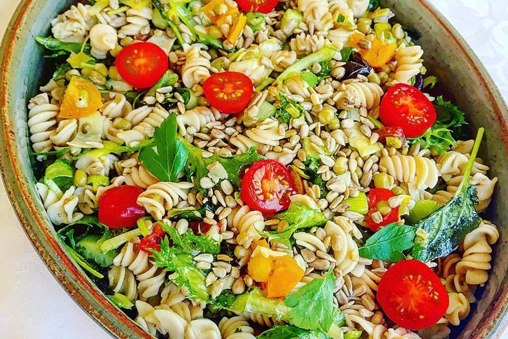 pasta and bean salad with fresh greens
