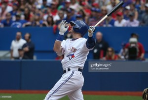 TORONTO, CANADA - JULY 1: Josh Donaldson #20 of the Toronto Blue Jays hits a two-run home run in the eighth inning during MLB game action against the Boston Red Sox on July 1, 2015 at Rogers Centre in Toronto, Ontario, Canada. (Photo by Tom Szczerbowski/Getty Images) *** Local Caption *** Josh Donaldson