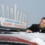 Rabbi Bruk with a car menorah