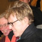 Redford (r), mensch, plunges into crowd to embrace Roger Ebert(l)
