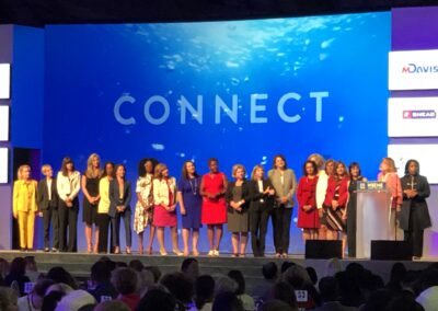 Carol stands on stage with other female CEO's at the WBENC Conf in Baltimore, MD.