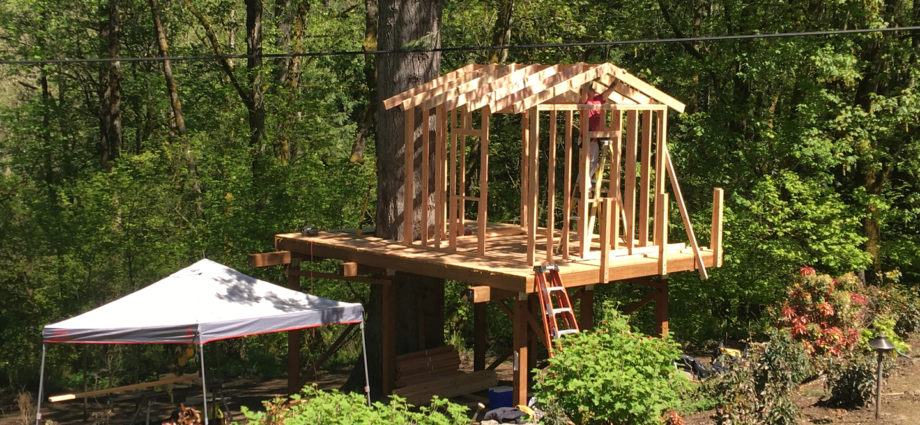 Deck with framed playhouse