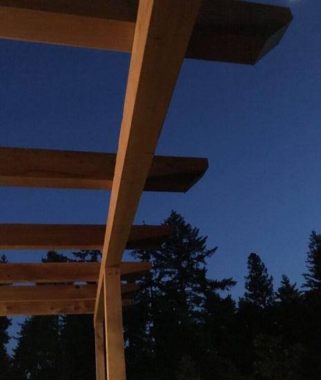 Pergola above deck against the night sky