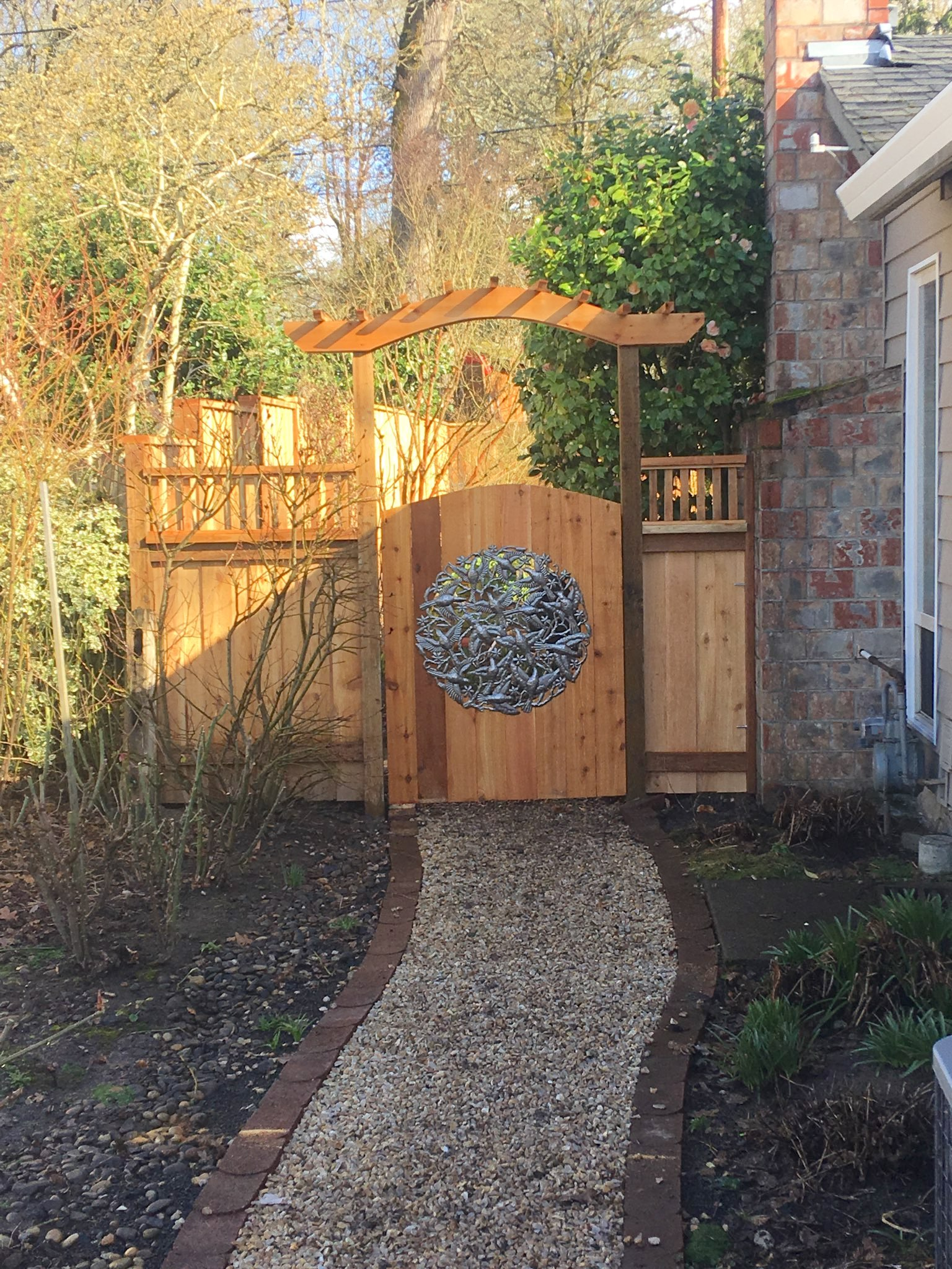 Custom gate with artwork and arbor