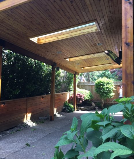 Patio cover with tongue and groove cedar ceiling, skylights