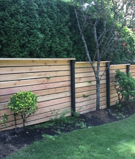cedar fence with horizontal boards and black posts