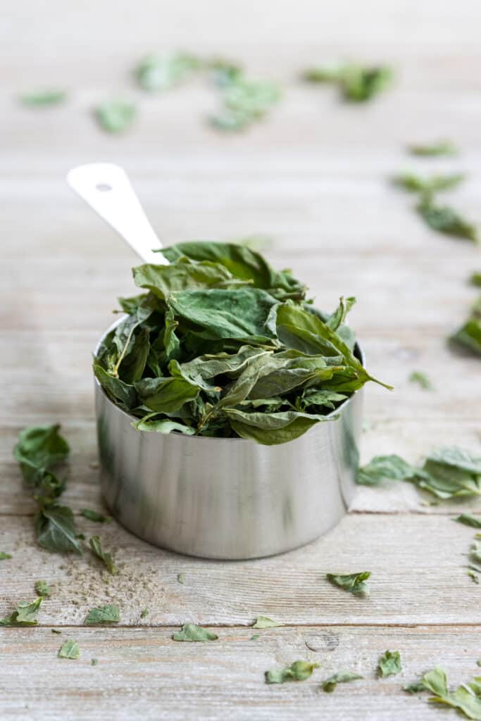 Freeze Dried Basil in a Measuring Cup