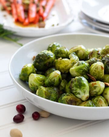 Roasted Garlicky Brussel Sprouts in a white Bowl