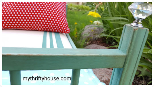 Baby doll bed painted with homemade aqua chalk paint and covered with drop cloth canvas.