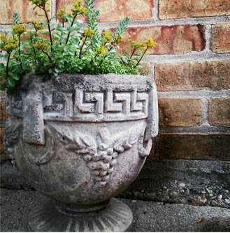 Cement urn used as unique flower planters