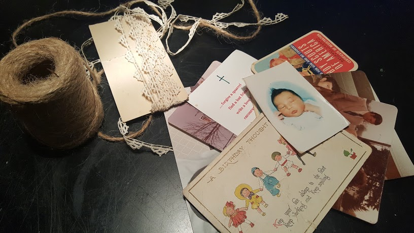 Twine and lace used to display keepsakes on the Book Page Memo Board.