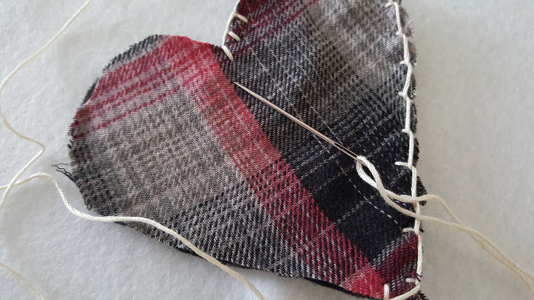 Just a simple whip stitch to sew the plaid flannel puffy heart Valentines.