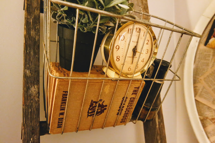 Rustic ladder with vintage wire baskets and vintage clock