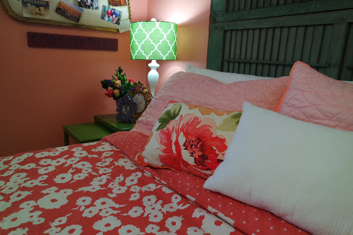 teenage girl bedroom with shutter headboard and pillows