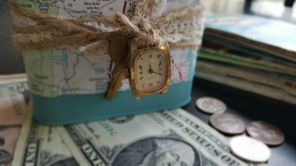 Travel fund coin bank decorated with a vintage map, twine, lace and trinkets