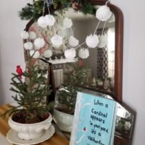 pom pom garland with cardinals and vintage mirror