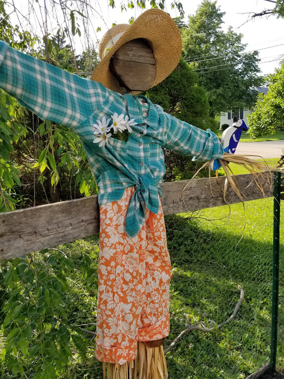 Cute garden scarecrow recycled from ugly scarecrow