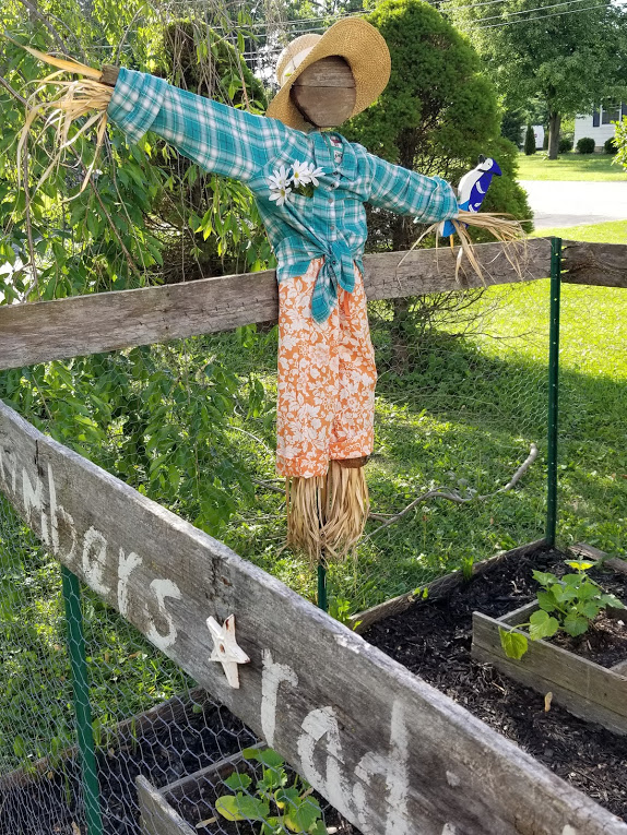 Cute garden scarecrow upcycled from ugly scarecrow
