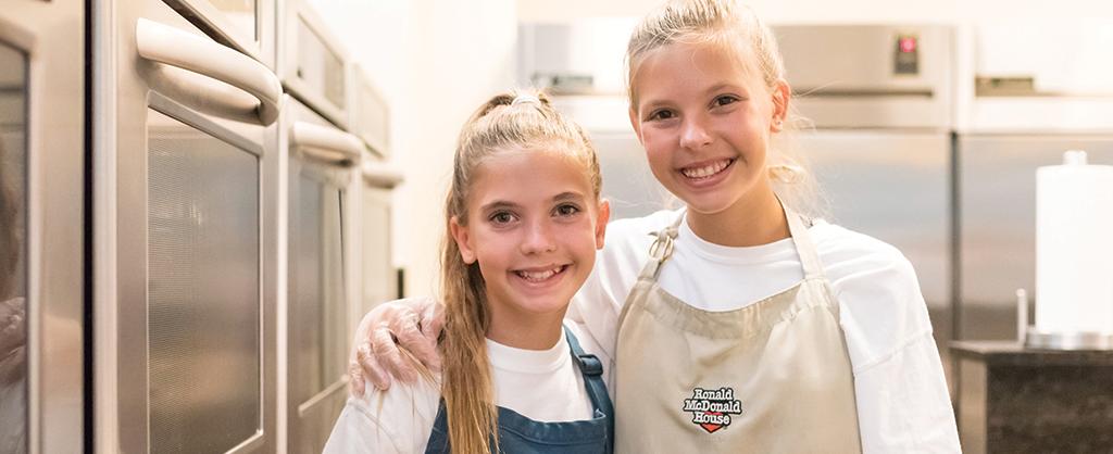 two girls in kitchen
