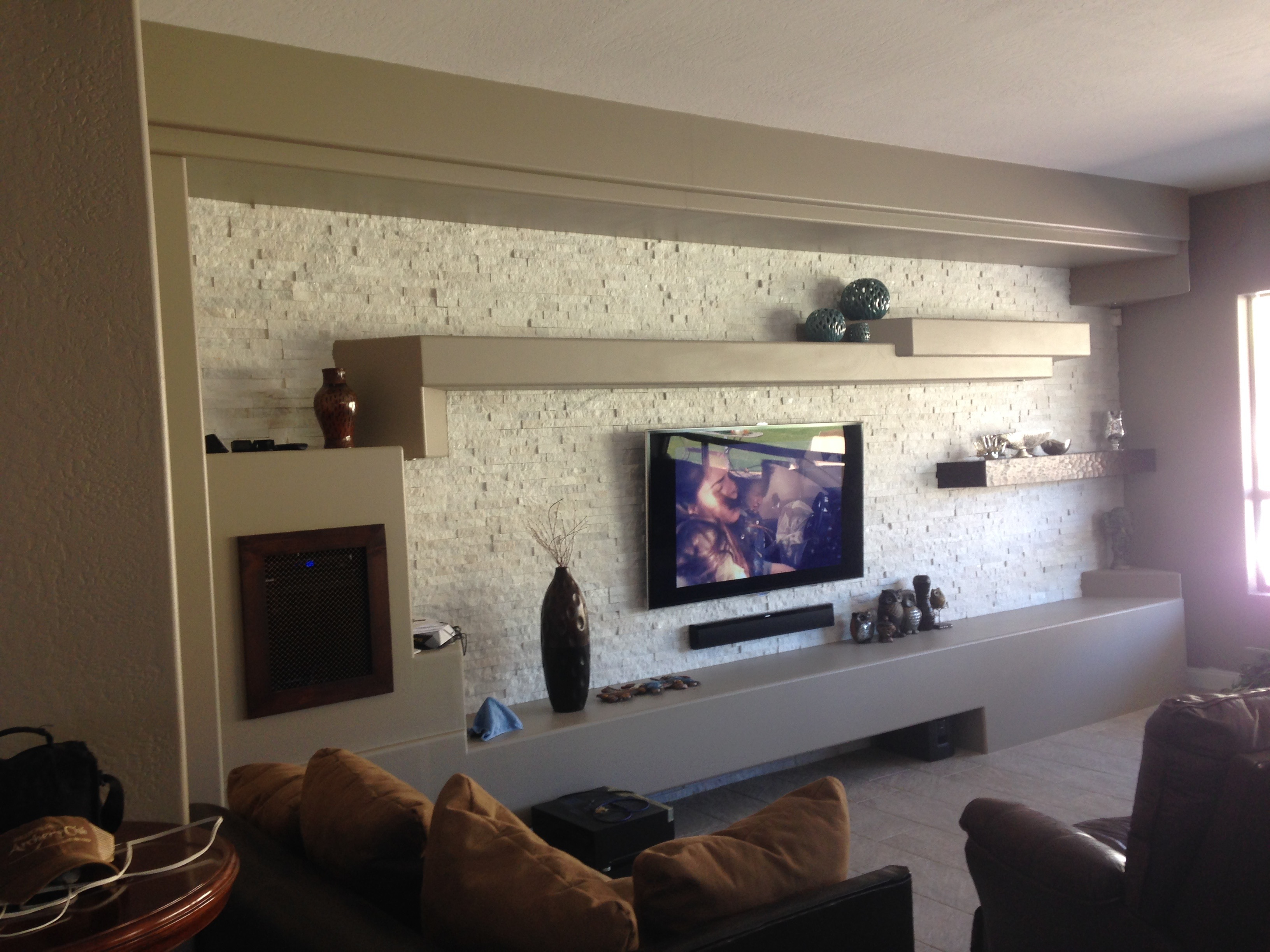 Living room wall, faux drywall, MDF painted wall, daggr design, fake drywall look with cabinetry, demo plastered wall, demo drywall entertainment center,