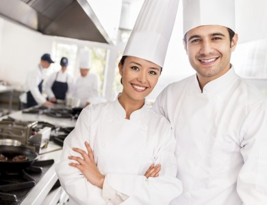 Team of chefs in a restaurant looking happy