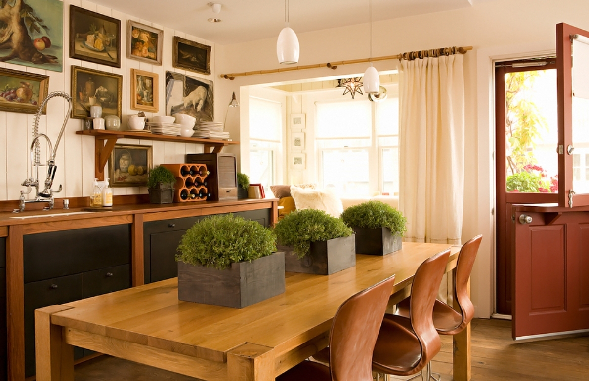 Charming-eclectic-kitchen-ideas-with-narrow-table-black-cabinets-white-wall-paint-kitchen-design