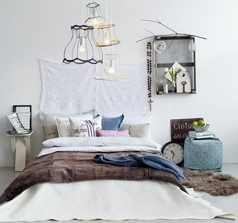 Eclectic bedroom with pendant lights