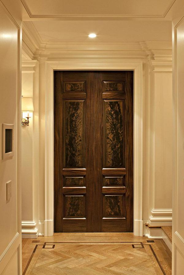 Fancy-Traditional-Entry-Design-Showing-Hardwood-Door-and-Chevron-Floor