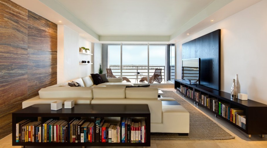 Cool-Apartment-Living-Room-Ideas-with-Cream-Fabric-Sofa-behind-Wooden-Bookshelf-and-TV-Cabinet