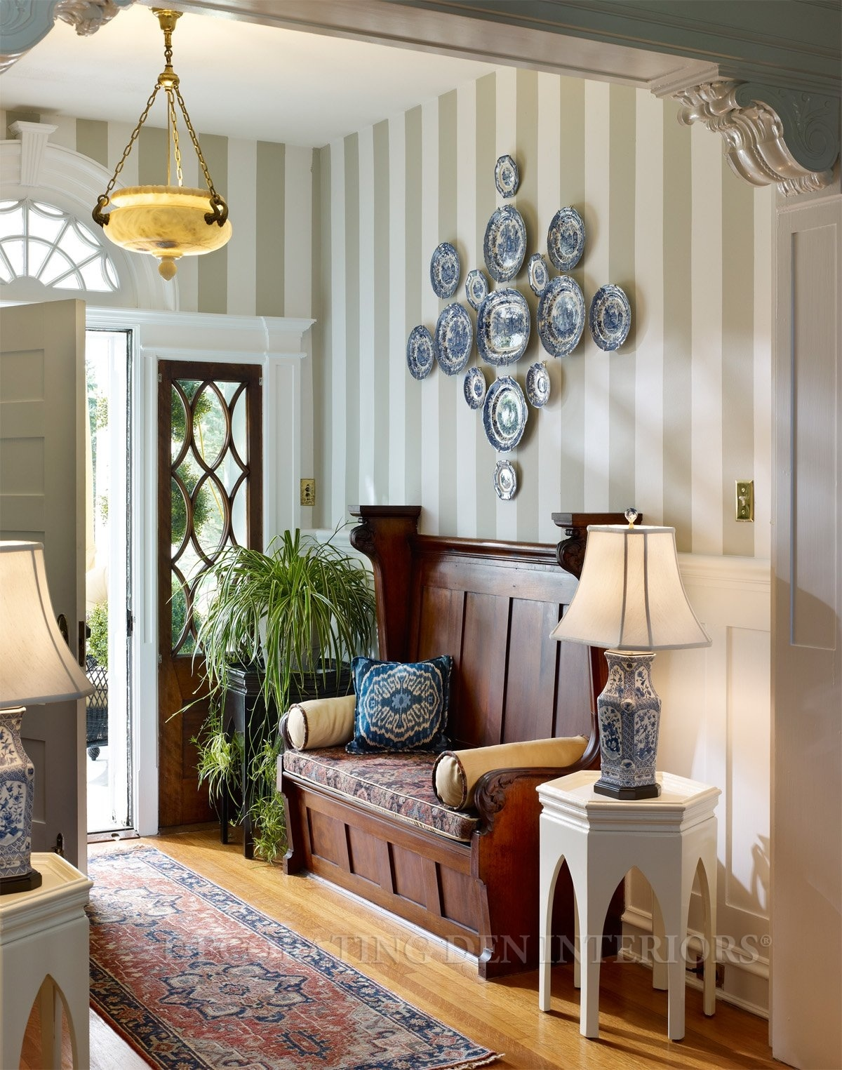 foyer_small-entryway-with-wood-flooring-area-rug-and-blue-china-accents