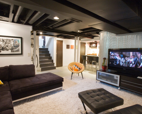 how-to-make-a-tray-ceiling-in-industrial-basement-with-white-fur-rug-elegant-black-sofas-wooden-cabinet-unique-chair-and-plafondlamp