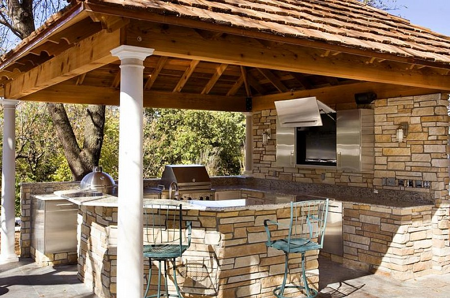 wall-tv-and-stainless-steel-access-door-plus-industrial-bar-stools-and-wooden-pergola-cover-in-superb-outdoor-kitchen-picture-design-ideas