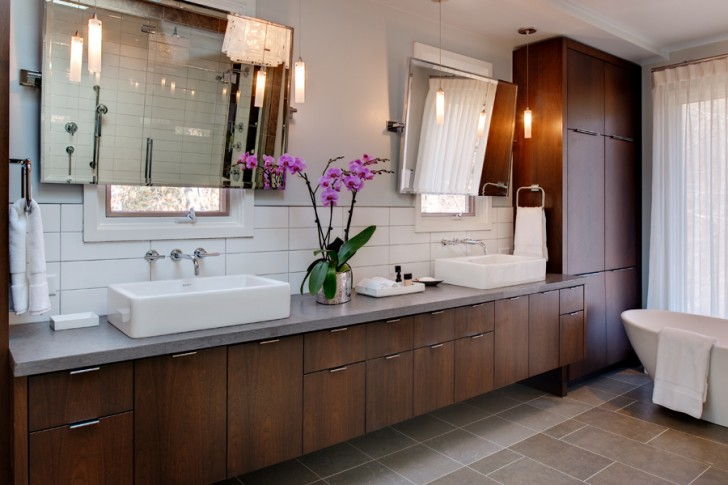 wondrous-mid-century-modern-bathroom-vanity-design-in-wooden-style-with-long-gray-countertop-with-mounted-sinks-beneath-frameless-wall-mirror-on-white-tile-backsplash-with-purple-orchid-728x485