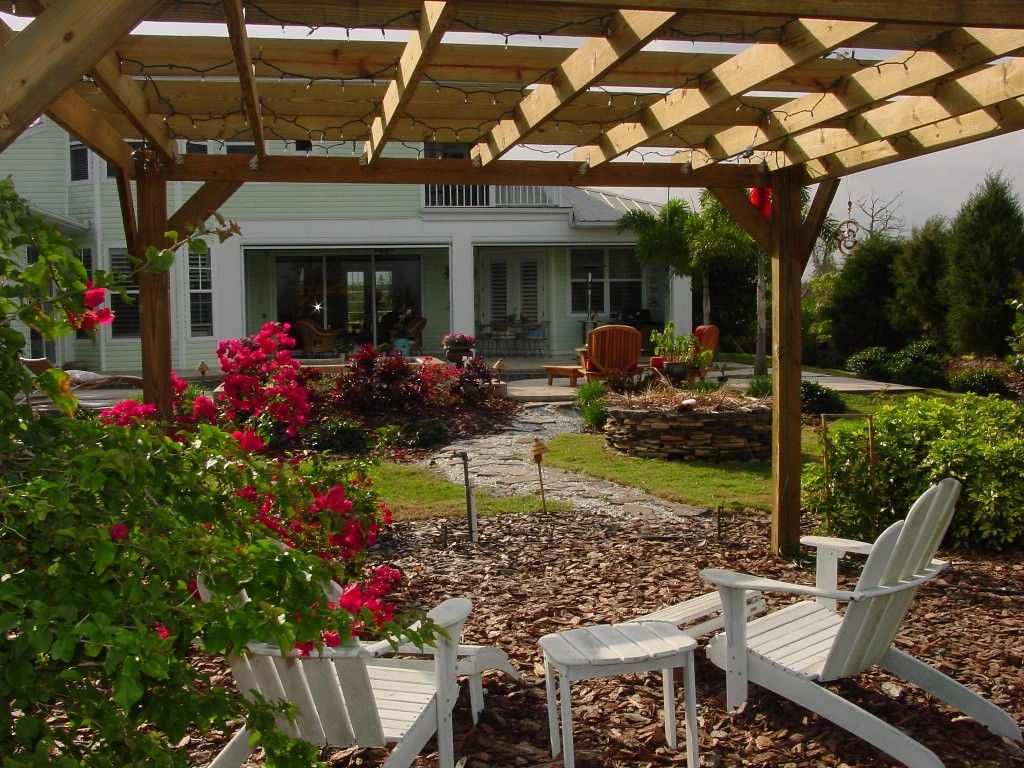 pergola with white chaer