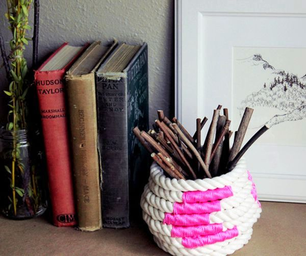 Fascinating-Home-Interior-Display-Including-DIY-Rope-Basket-for-Wood-Sticks-Completed-with-Books-Standing-Beside-Flower-Vase-on-Brown-Basement