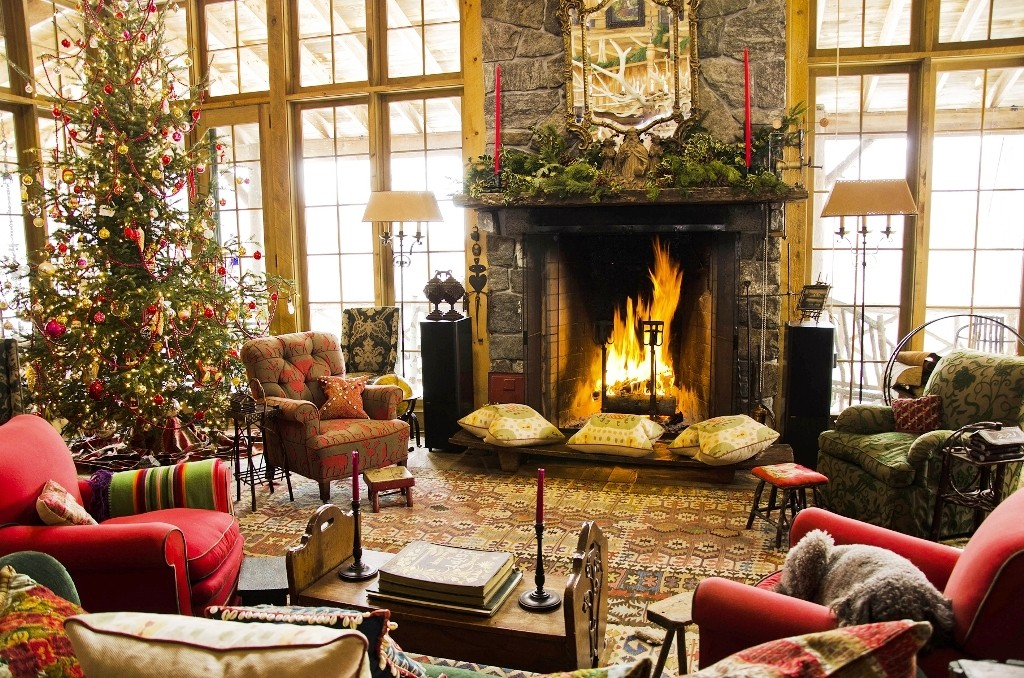 a fireplace with christmas tree