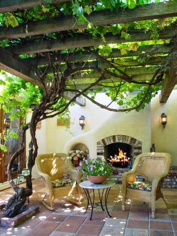 small-patio-ideas-fireplace-outdoor-furniture-wooden-pergola-grapevines